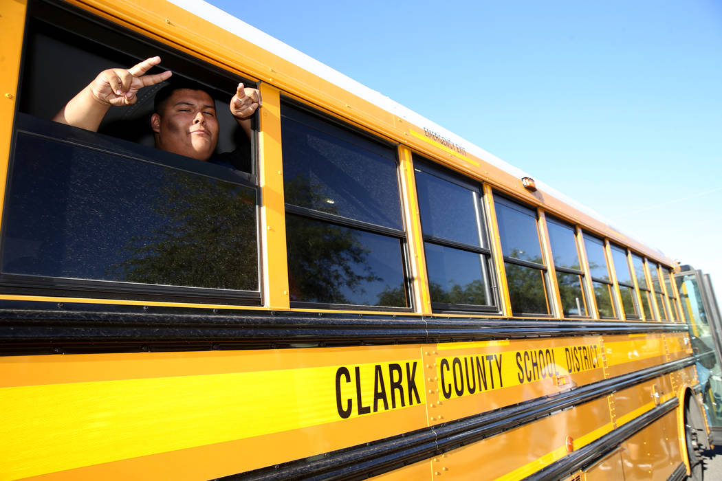 A Sunrise Mountain High School student poses on the school bus at East Owens Avenue and North B ...