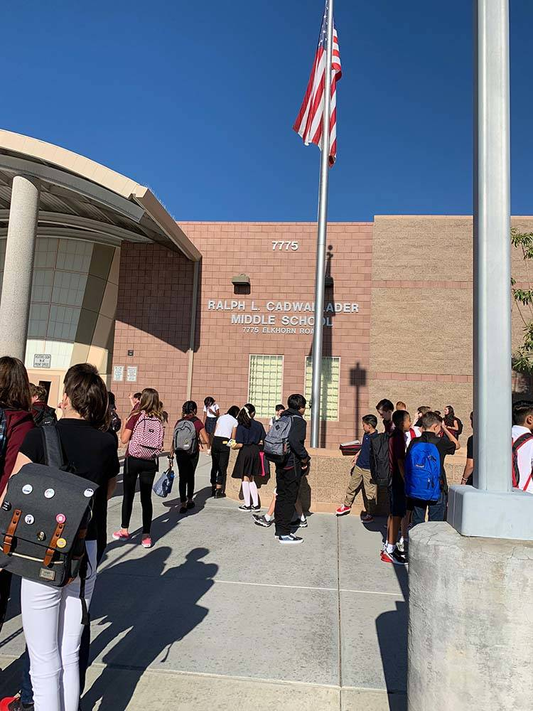 Cadwallader Middle School students arrive for the first day of classes, Monday, Aug. 12, 2019. ...