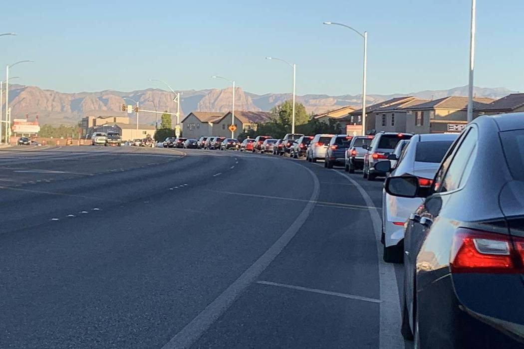Cars are lined up at Liberty High School for the first day of the 2019-20 school year, Monday, ...