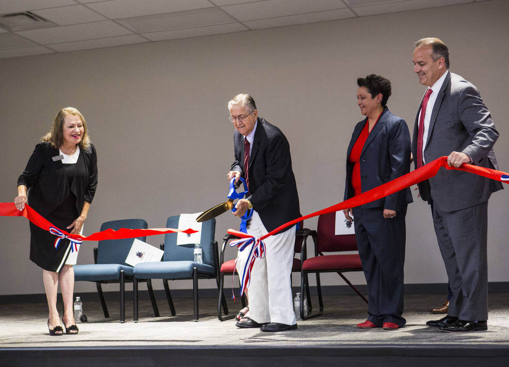 Long-time educator Earl Jenkins, second from left, cuts the ribbon alongside, from left, Distri ...