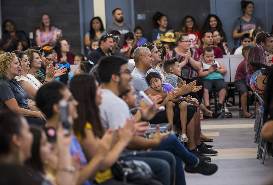 Attendees clap during a ribbon-cutting ceremony for Earl Jenkins Elementary School in east Las ...