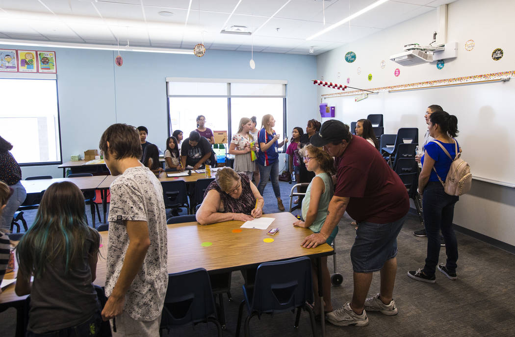 Students and parents explore classrooms after a ribbon-cutting ceremony for Earl Jenkins Elemen ...