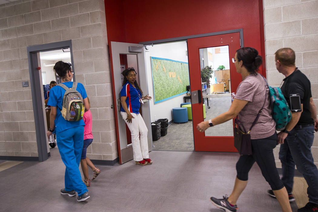 Librarian Kimberly Murray welcomes visitors after a ribbon-cutting ceremony for Earl Jenkins El ...