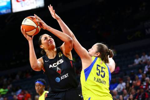 Las Vegas Aces' Liz Cambage shoots around Dallas Wings' Theresa Plaisance (55) during the first ...