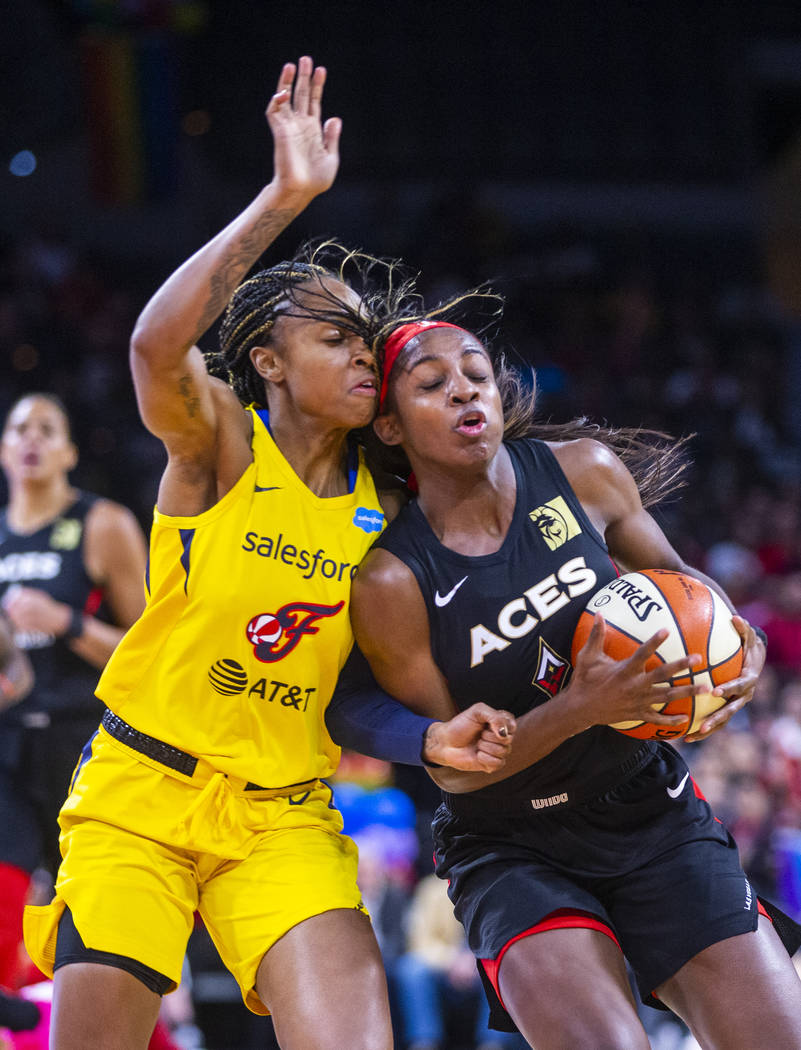 Indiana Fever guard Kelsey Mitchell (0) bodies up with Las Vegas Aces guard Sugar Rodgers (14) ...