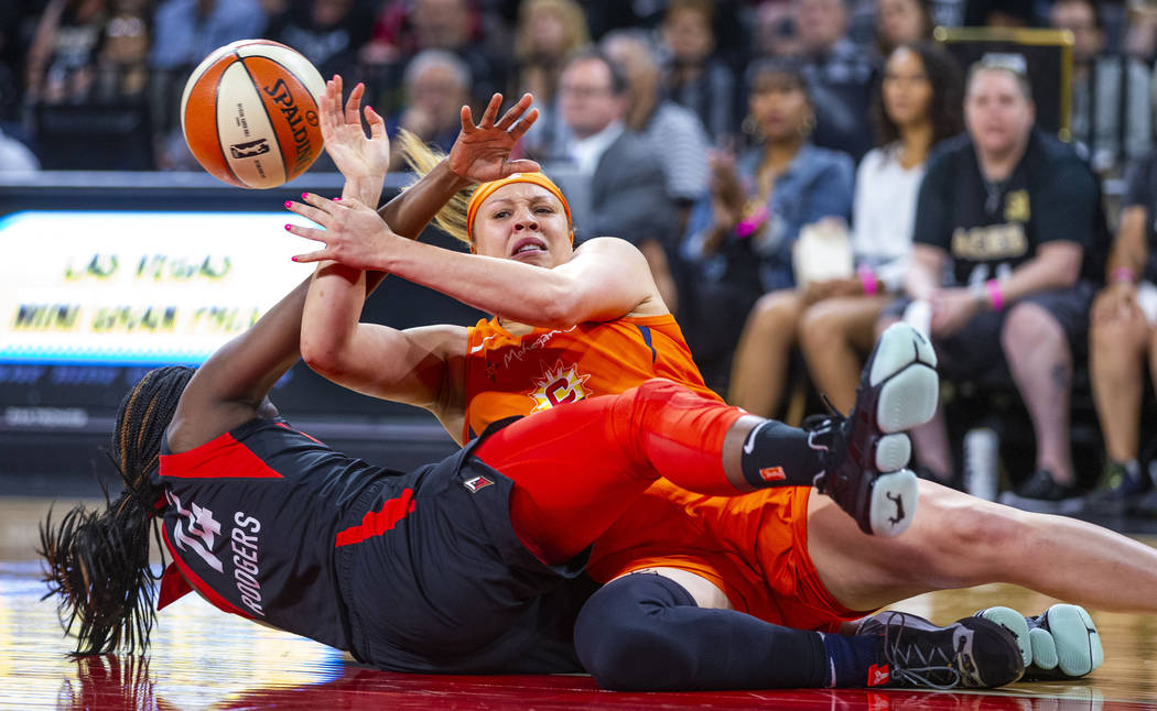 Las Vegas Aces guard Sugar Rodgers (14) rips the ball from Connecticut Sun guard Rachel Banham ...