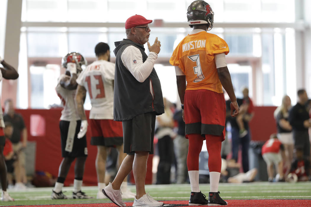 Tampa Bay Buccaneers head coach Bruce Arians talks to quarterback Jameis Winston (3) during an ...