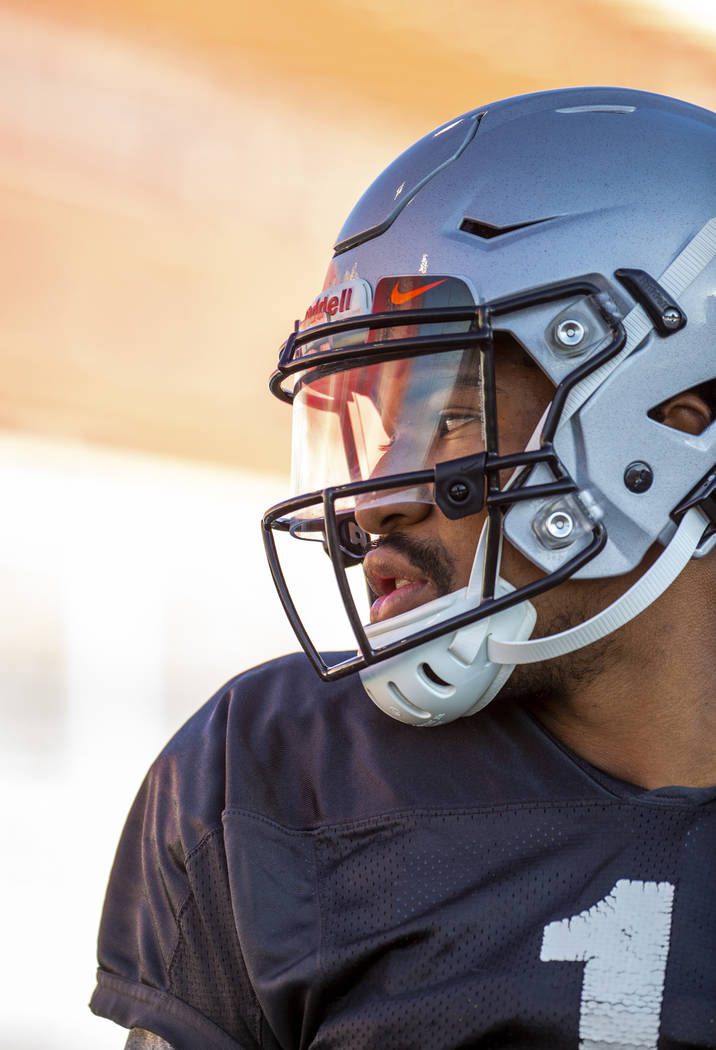 UNLV QB Armani Rogers (1) looks to his teammates during their first major scrimmage of football ...