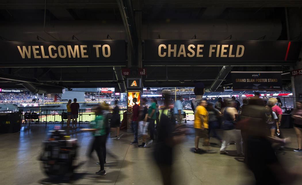 Fans arrive before the start of an Arizona Diamondbacks baseball game against the Philadelphia ...