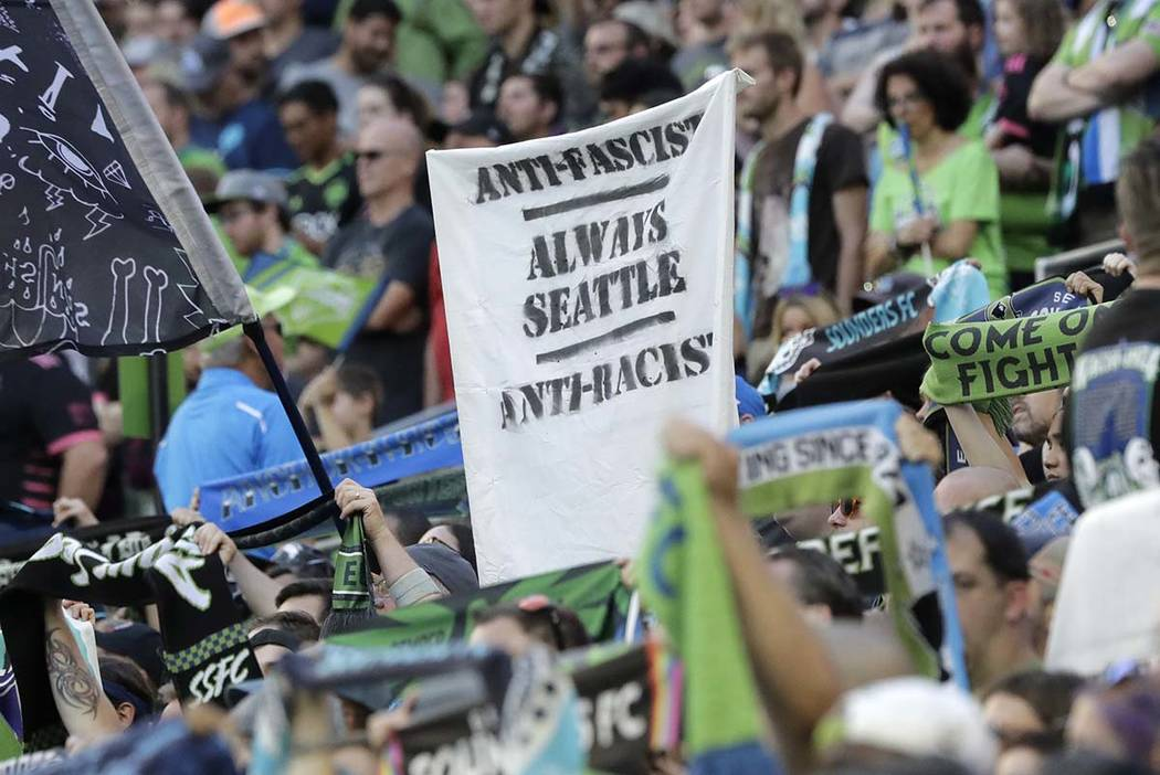 """In this July 21, 2019, photo, a sign that reads """"Anti-Facist Always Seattle Anti-Racist&qu ..."""