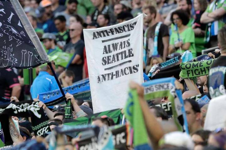 "In this July 21, 2019, photo, a sign that reads ""Anti-Facist Always Seattle Anti-Racist&qu ..."