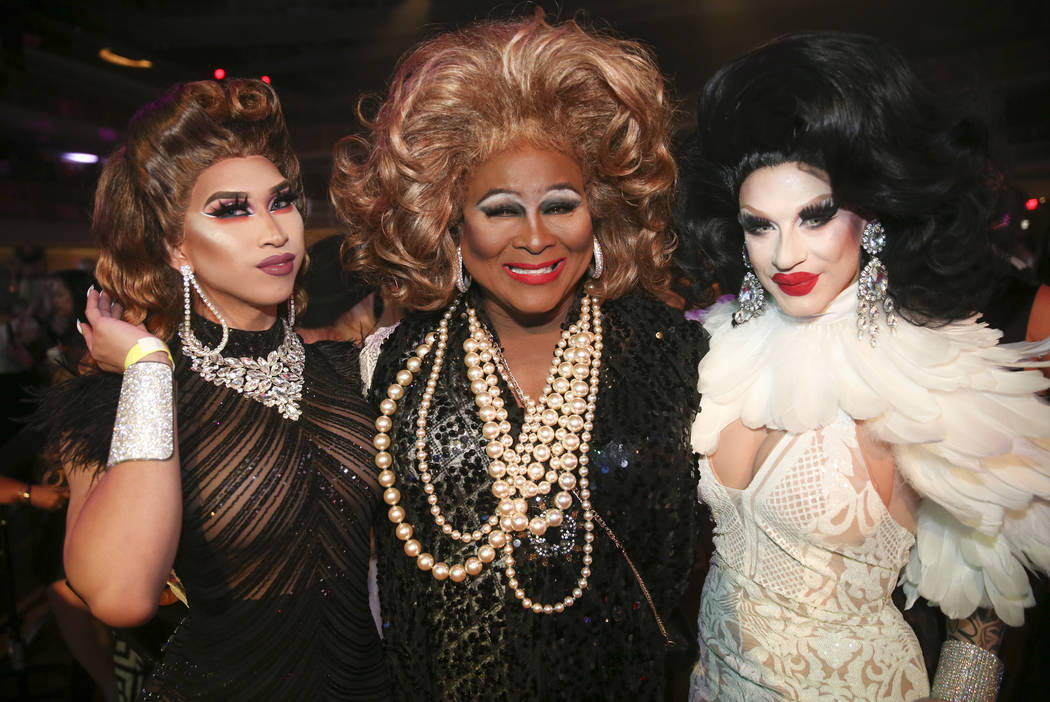 Asia King Adour, from left, Larry Edwards and London Adour during the Aid for AIDS of Nevada 33 ...