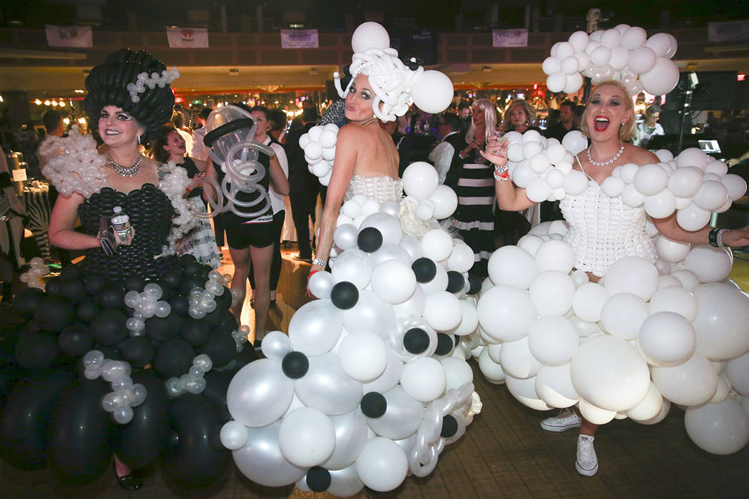 Jill Martin, from left, Amie Vreeken and Julie Lane dance during the Aid for AIDS of Nevada 33 ...