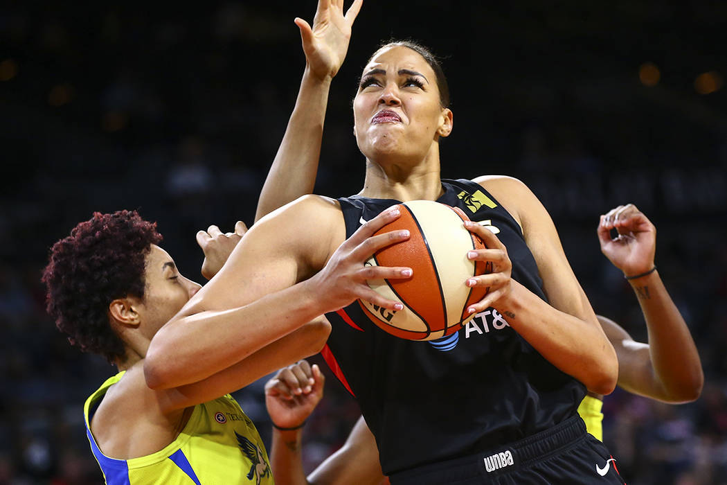 Las Vegas Aces' Liz Cambage drives to the basket against Dallas Wings' Isabelle Harrison during ...