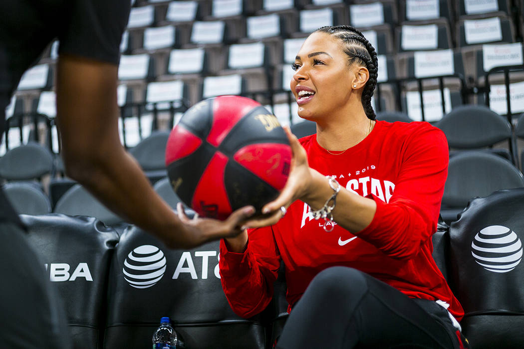 Las Vegas Aces' Liz Cambage hands a signed ball over ahead of the WNBA All-Star Game and skills ...
