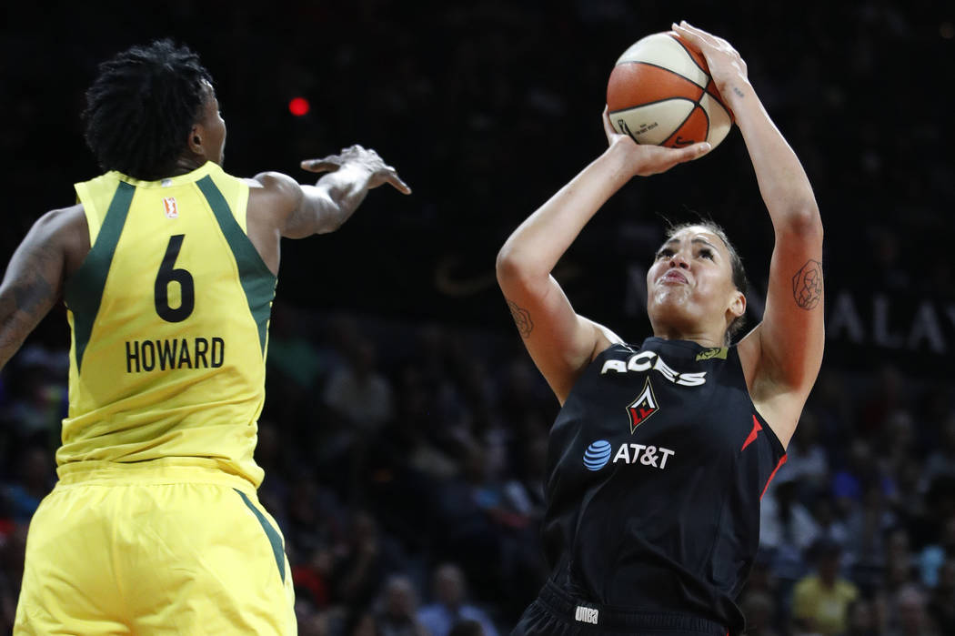 Las Vegas Aces' Liz Cambage shoots around Seattle Storm's Natasha Howard during the first half ...