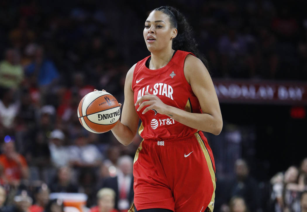 Las Vegas Aces' Liz Cambage, of Team Wilson, drives upcourt against Team Delle Donne during the ...