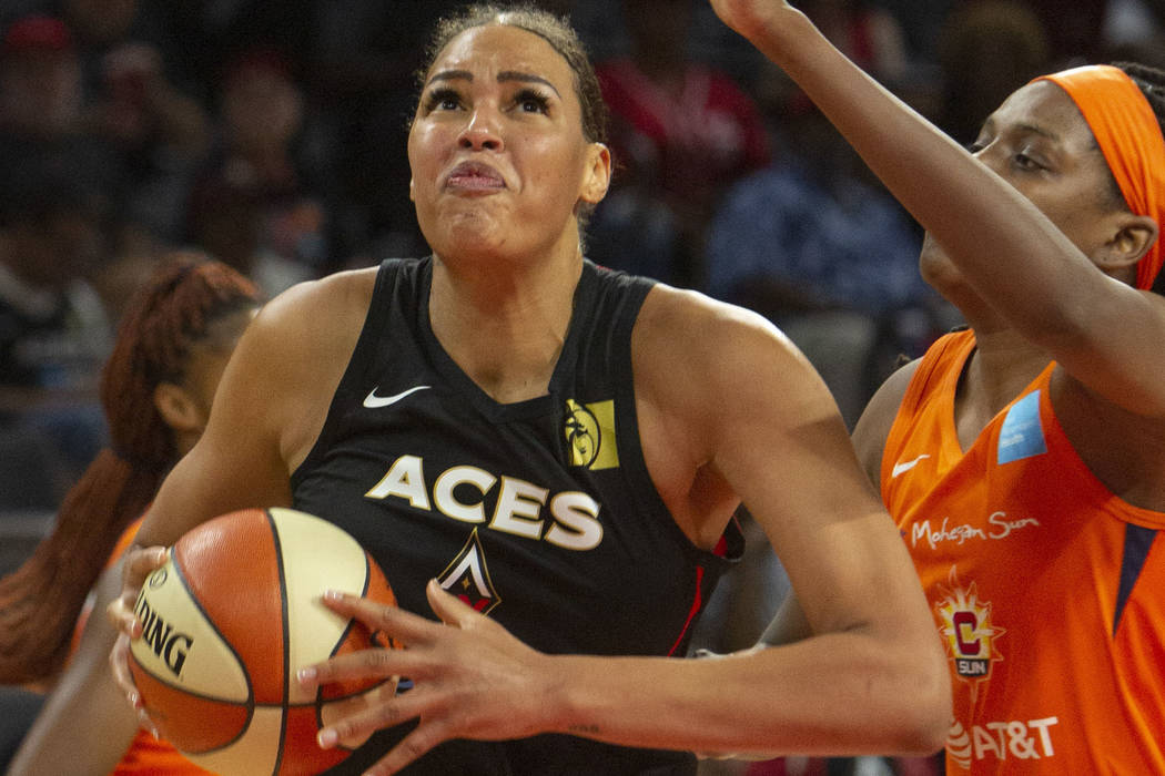 Las Vegas Aces center Liz Cambage (8), left, goes to the hoop against Connecticut Sun center Jo ...