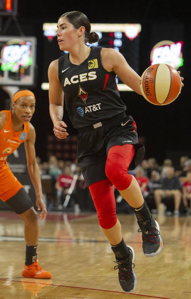 Las Vegas Aces guard Kelsey Plum (10) sets up a play against Connecticut Sun players during the ...
