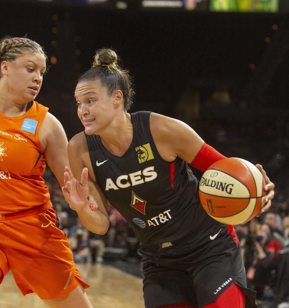 Las Vegas Aces guard Kayla McBride (21) runs to the hoop against Connecticut Sun guard Rachel B ...