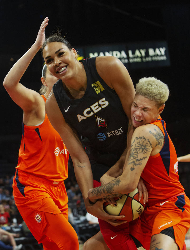 Las Vegas Aces center Liz Cambage (8) laughs as Connecticut Sun guard Natisha Hiedeman (2) trie ...