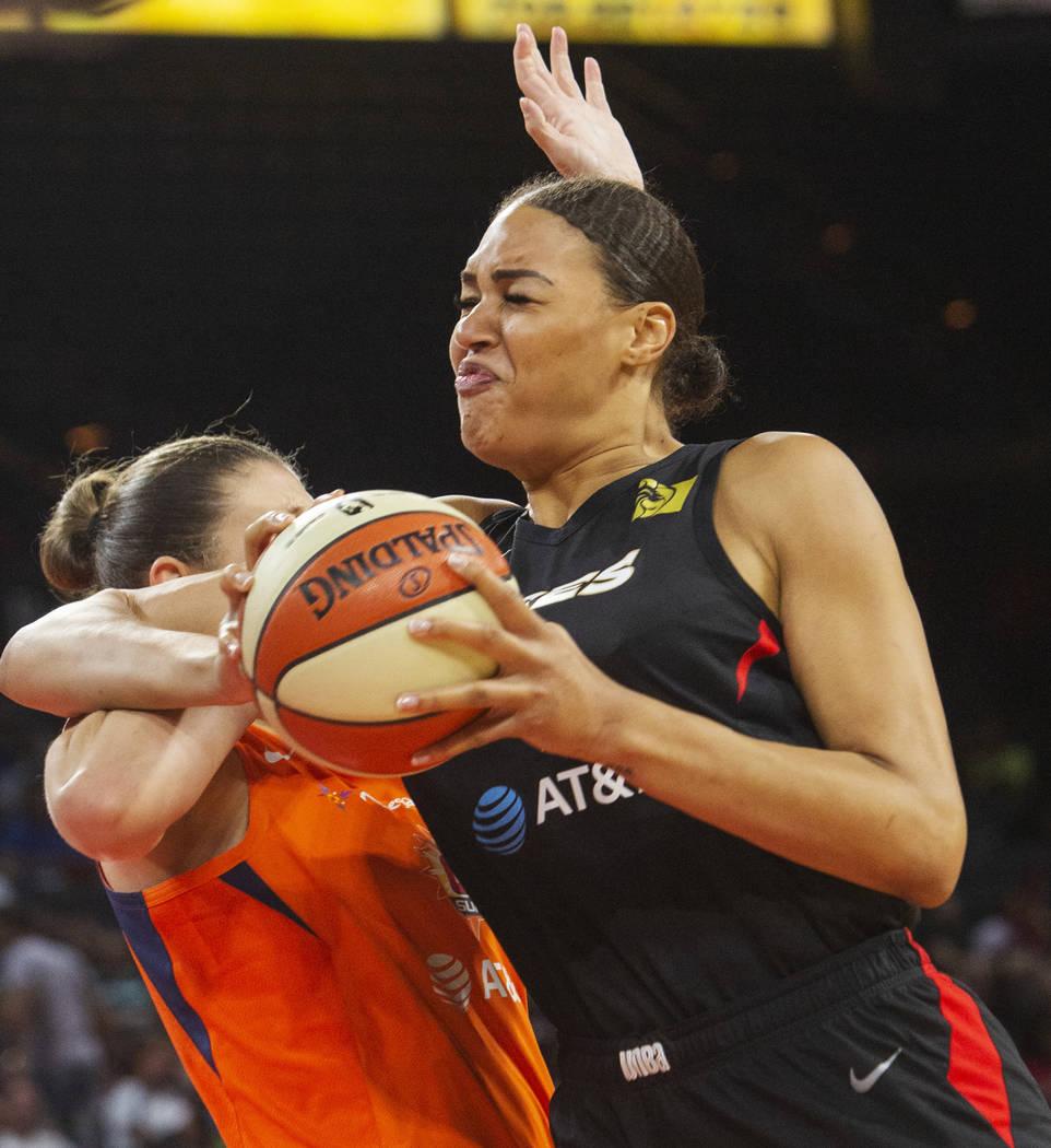 Las Vegas Aces center Liz Cambage (8) attempts a play against Connecticut Sun center Theresa Pl ...