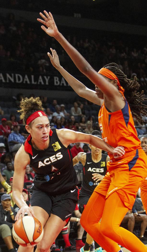 Las Vegas Aces forward Dearica Hamby (5) sets up a play against Connecticut Sun forward/center ...