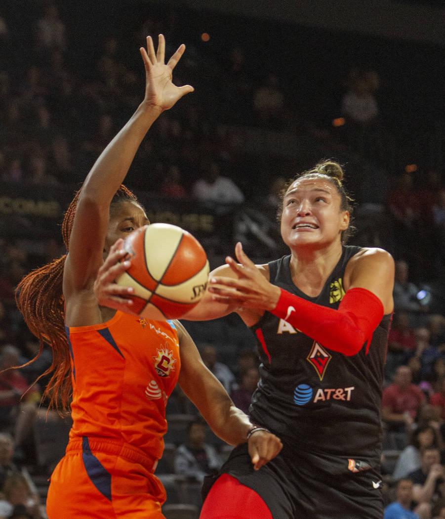 Las Vegas Aces guard Kayla McBride (21) sets up a play against Connecticut Sun guard Bria Holme ...