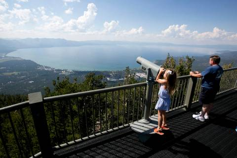 FILE - In this Aug. 8, 2017, file photo, Lilyana Allen, of Guam, uses a telescope to view Lake ...