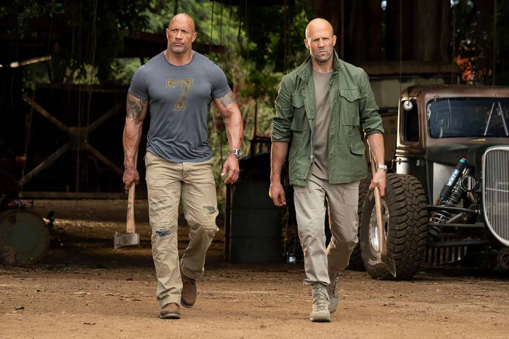 This image released by Universal Pictures shows Dwayne Johnson, left, and Jason Statham in a sc ...