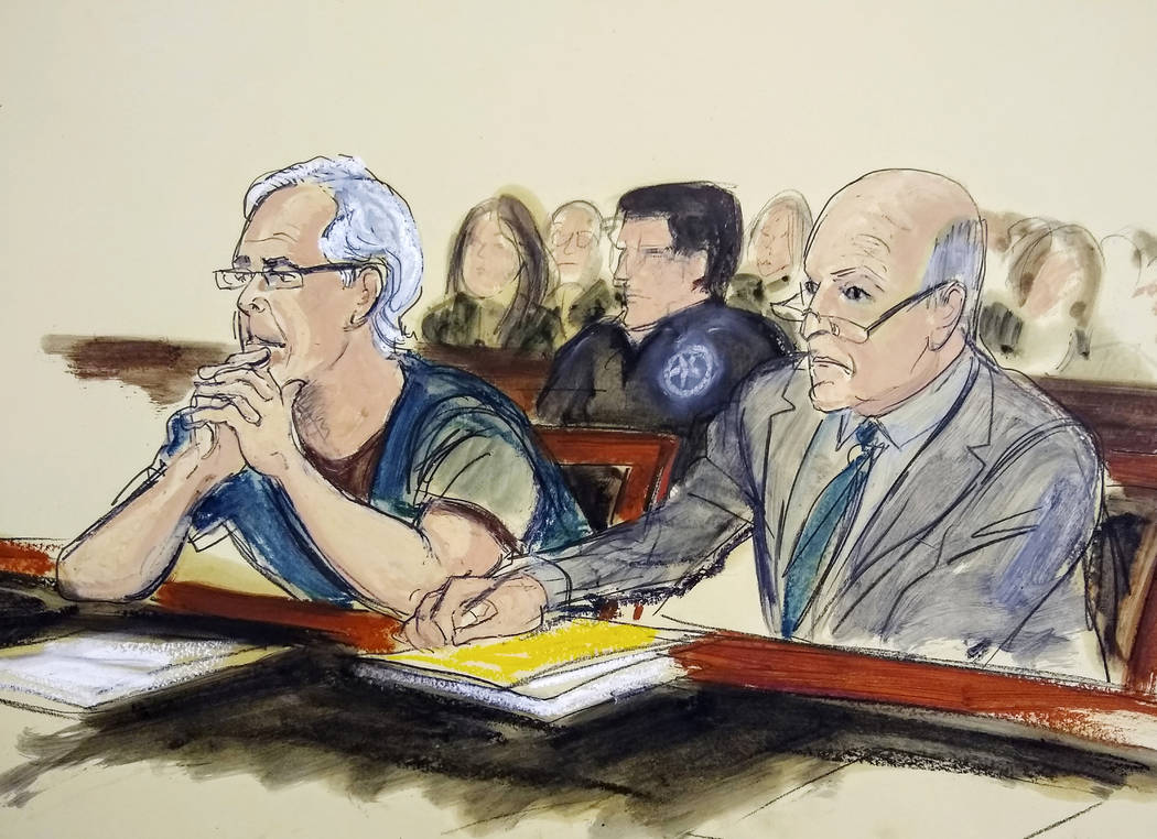 FILE - In this July 15, 2019 courtroom artist's sketch, defendant Jeffrey Epstein, left, and hi ...