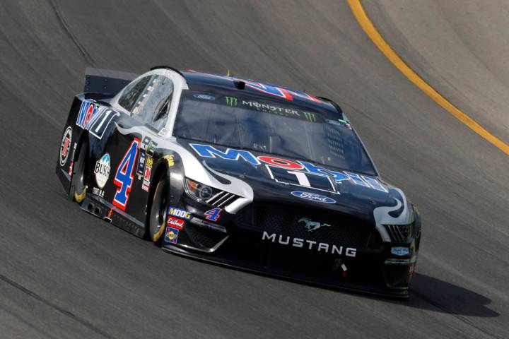 Kevin Harvick races out of turn one during a NASCAR Cup Series auto race at Michigan Internatio ...