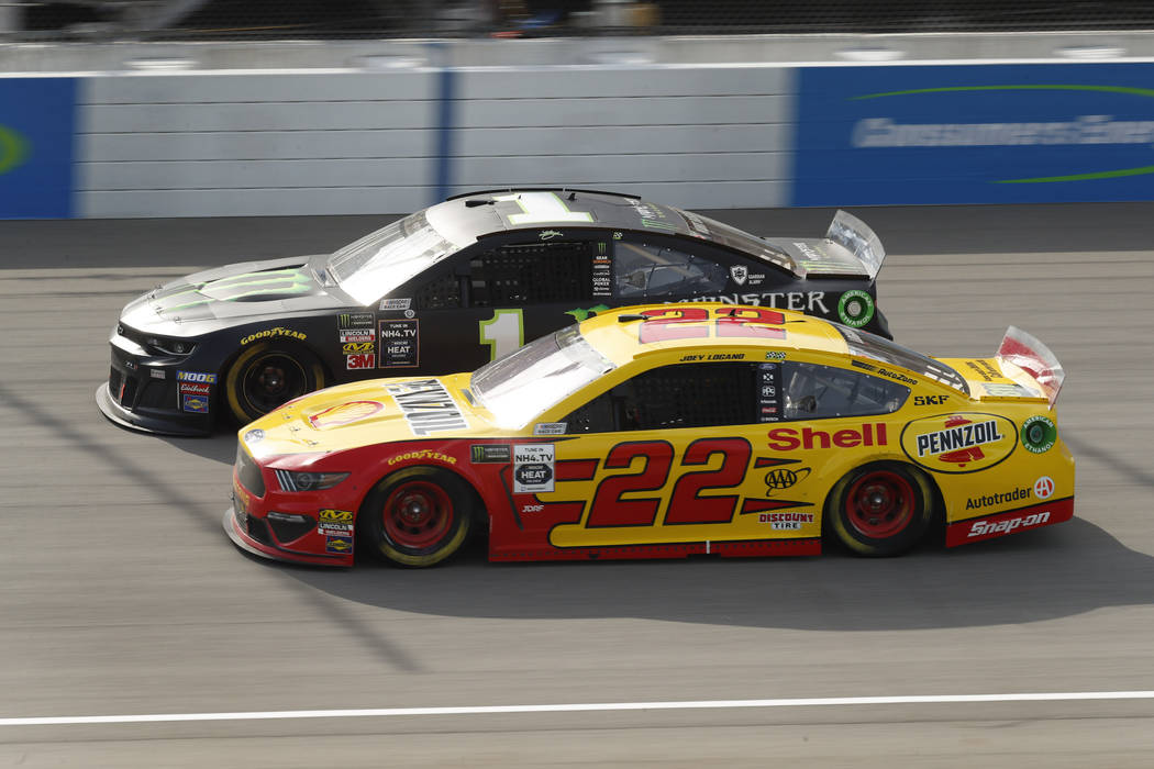Joey Logano (22) races Kurt Busch (1) during a NASCAR Cup Series auto race at Michigan Internat ...