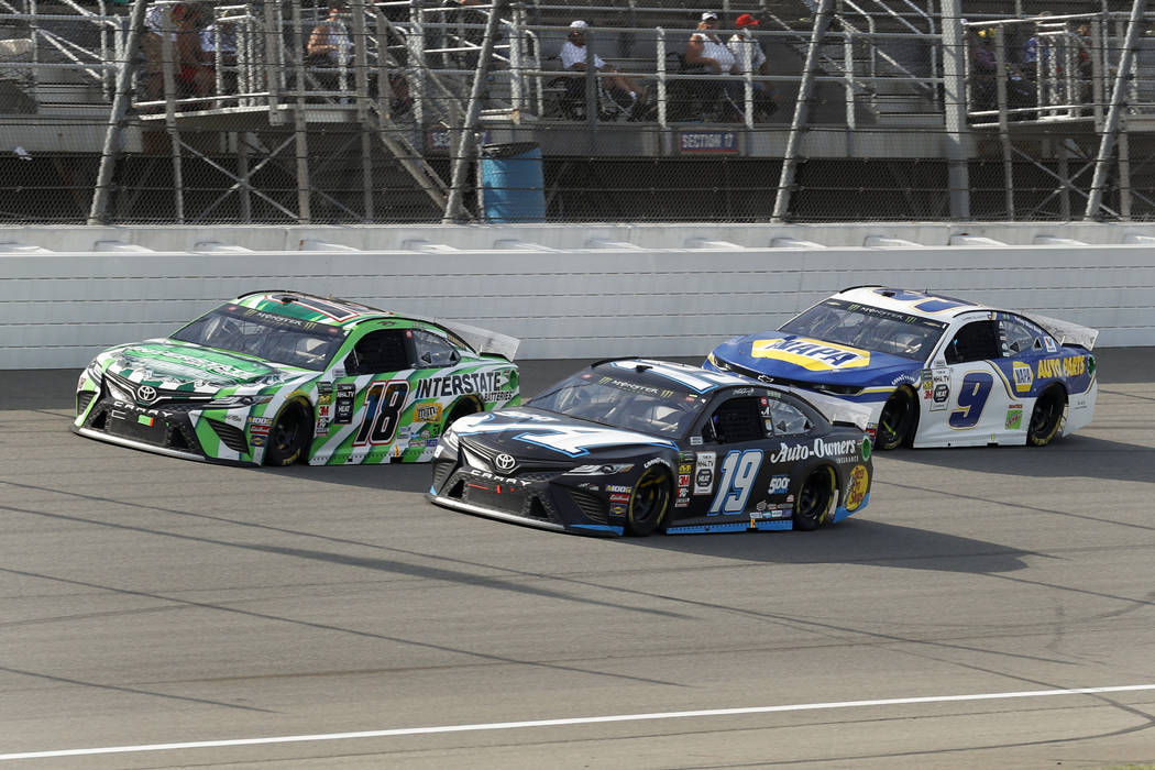 Kyle Busch (18), Martin Truex Jr. (19) and Chase Elliott (9) race during a NASCAR Cup Series au ...
