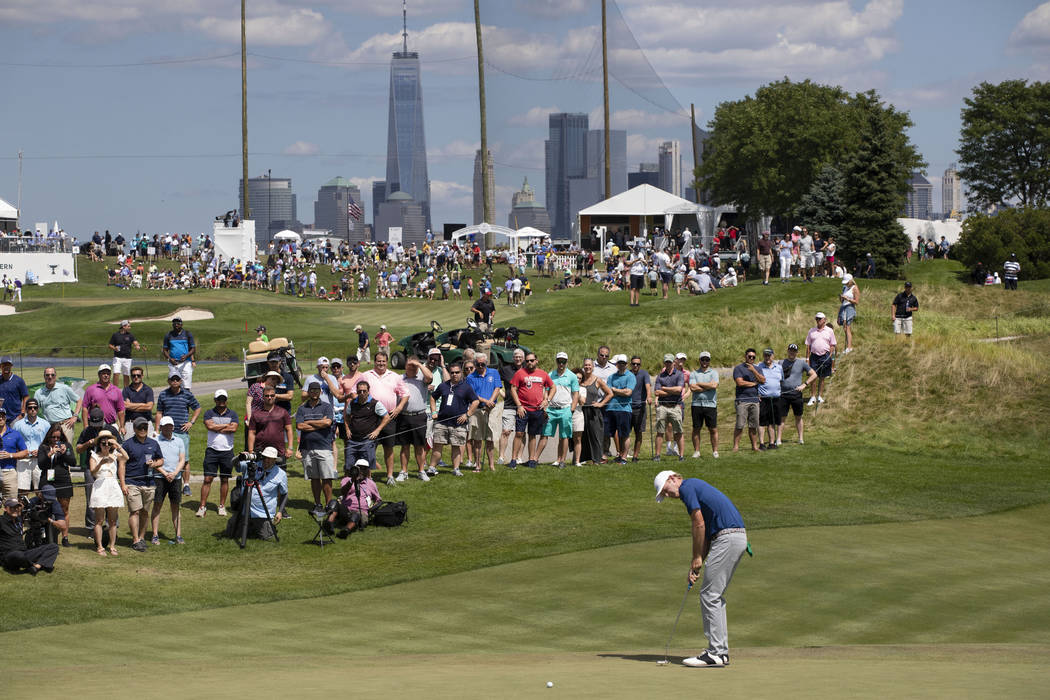 Brandt Snedeker putts on the third hole in the final round of the Northern Trust golf tournamen ...