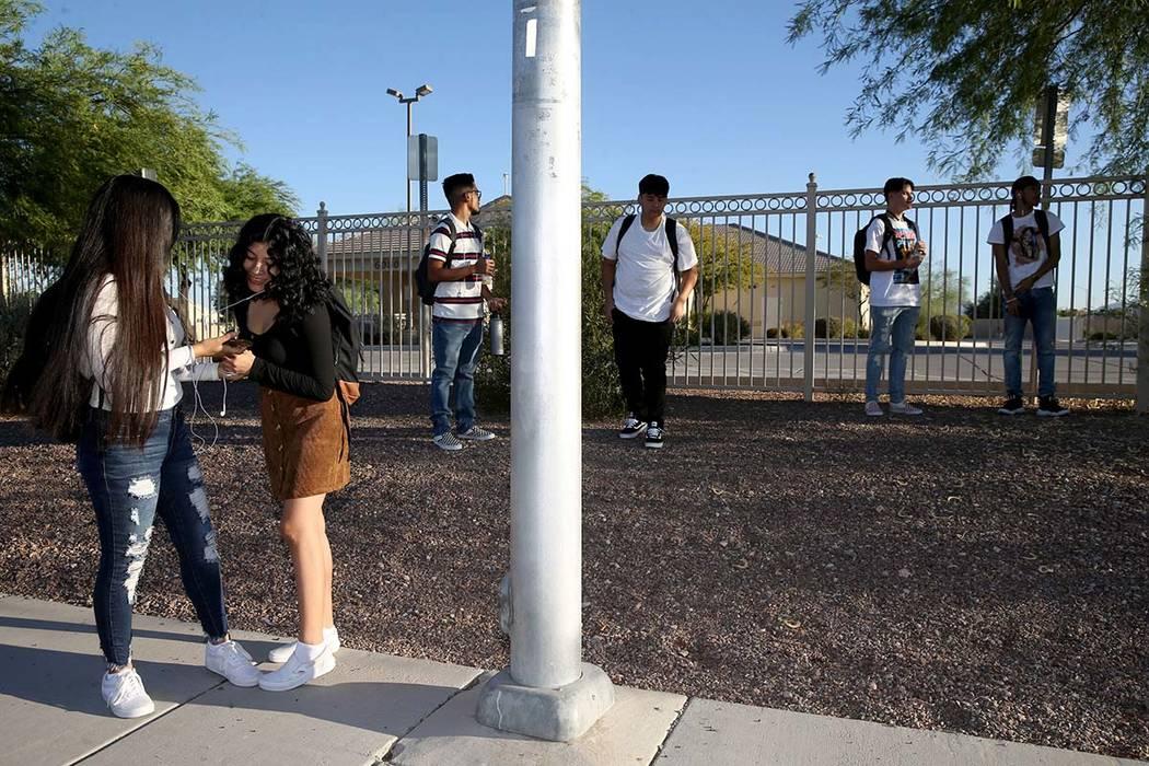 Sunrise Mountain High School senior Azaleah Saldana, left, and her sister Nevaeh Saldana, a sop ...