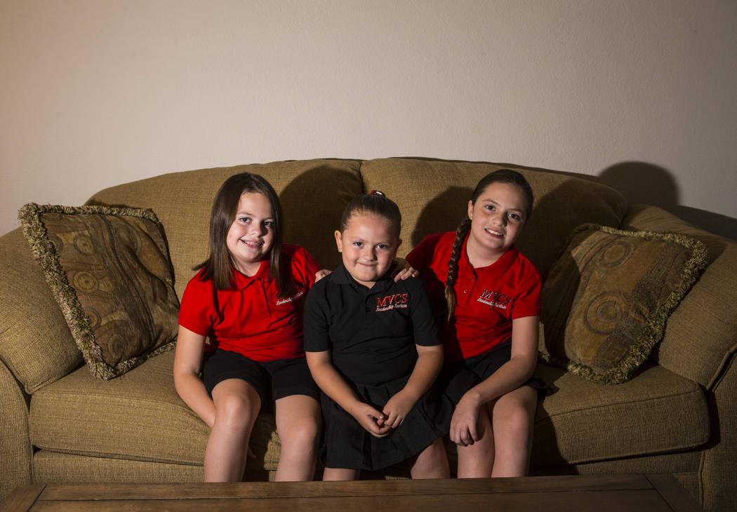 Sisters, from left, Trinity Ybarra, 8, Nala Ybarra, 5, and Elia Ybarra, 9, at their home in Las ...