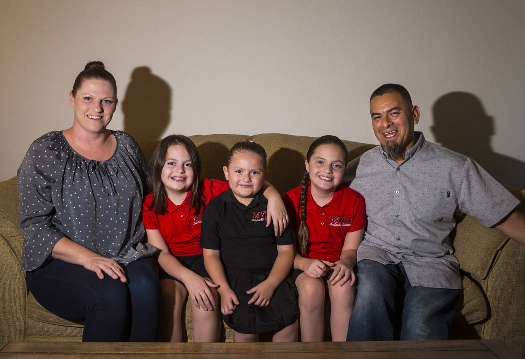 Bonnie Ybarra, left, poses with children and husband, from left, Trinity, 8, Nala, 5, and Elia, ...