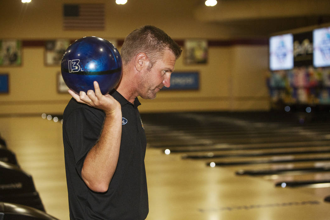 Nascar professional Clint Bowyer eyes his shot while bowling at South Point on Monday, Aug. 12, ...