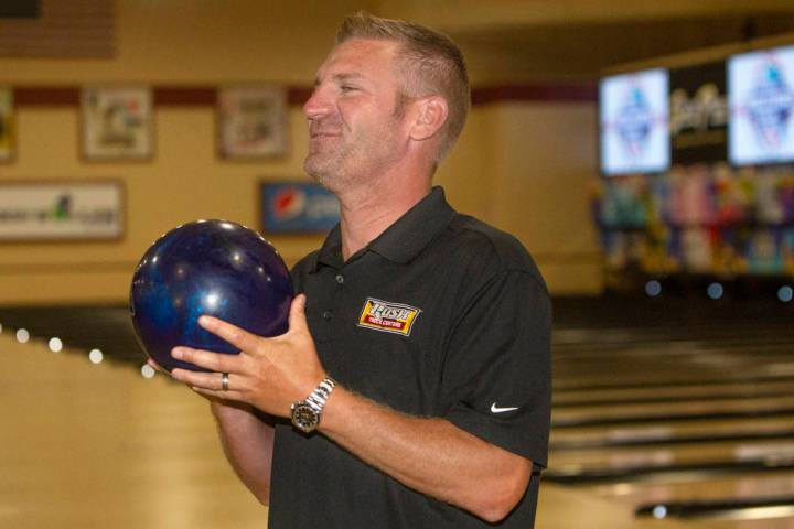 Nascar professional Clint Bowyer smiles as he prepares to eye his shot during a bowling match a ...