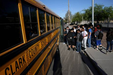 Sunrise Mountain High School students board the school bus at East Owens Avenue and North Beesl ...