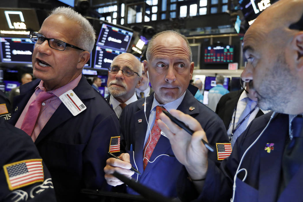 Michael Urkonis, second from right, works with fellow traders on the floor of the New York Stoc ...