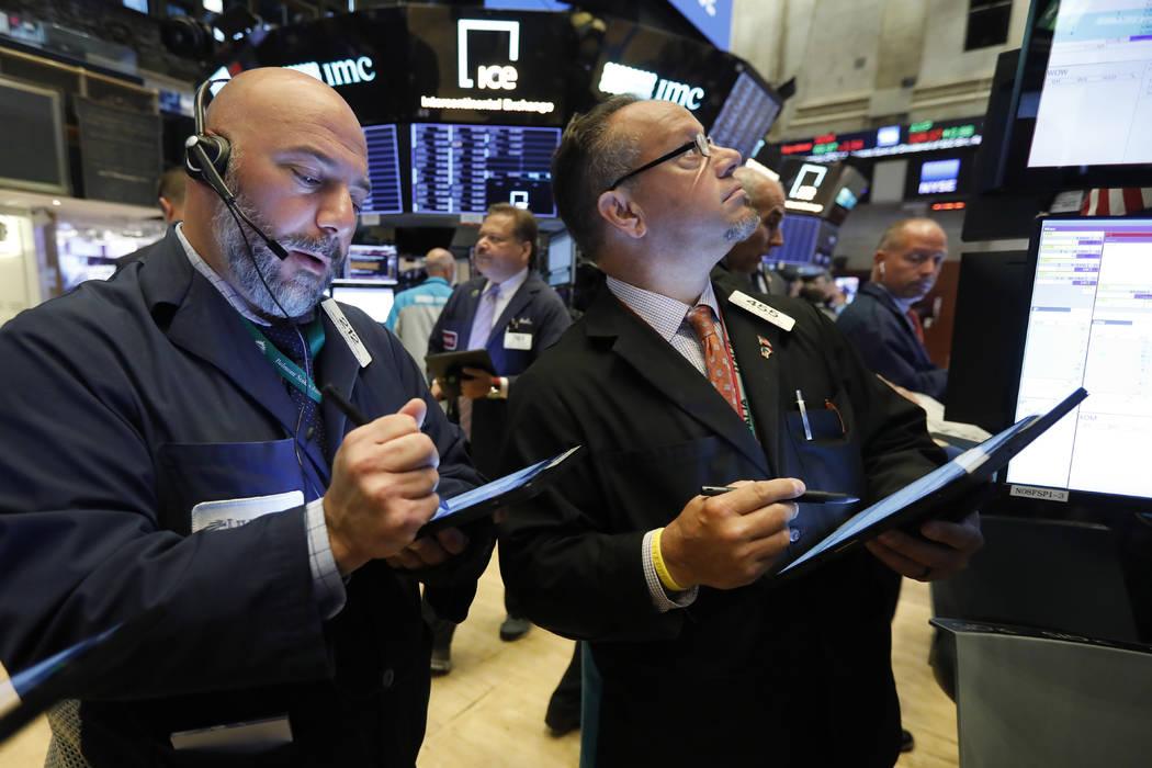 Traders Vincent Napolitano, left, and Robert Arciero work on the floor of the New York Stock Ex ...