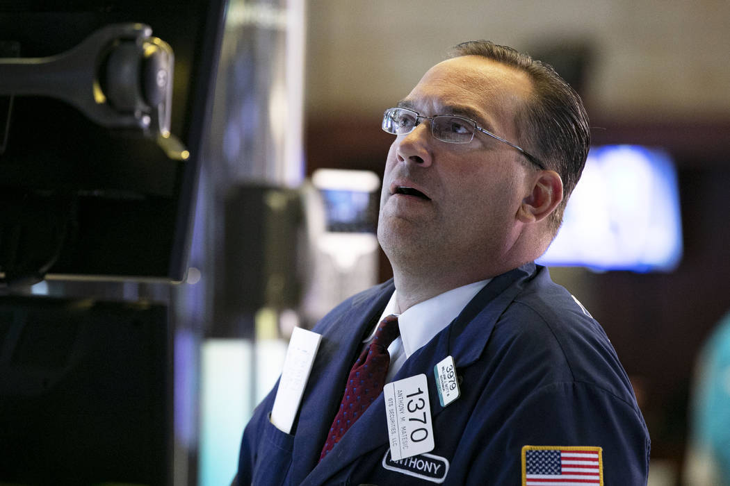 Specialist Anthony Matsic works at his post on the floor of the New York Stock Exchange, Monday ...