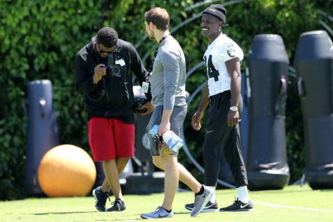 Oakland Raiders wide receiver Antonio Brown (84), right, walks on the field during the NFL team ...