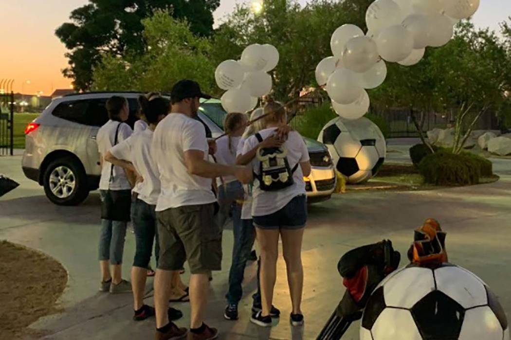 Mourners start arriving on Monday, Aug. 12, 2019, at Desert Breeze Park for a candlelight vigil ...