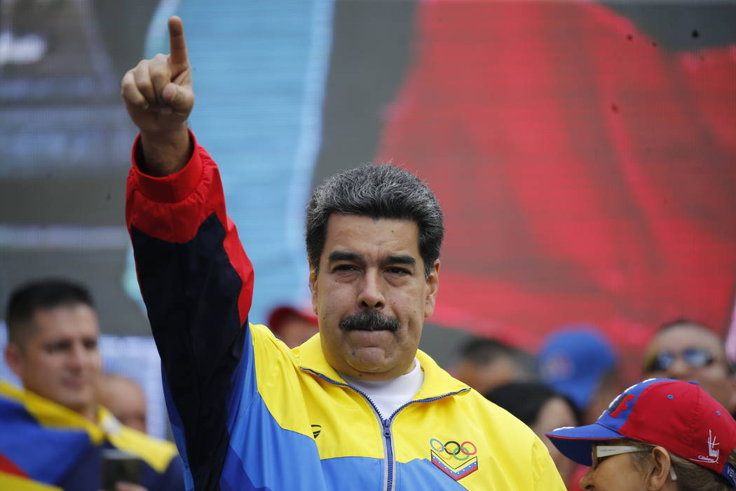 Venezuela's President Nicolas Maduro and first lady Cilia Flores, right, lead a rally condemnin ...