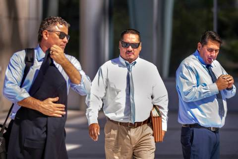 Counselor Mark Fleming, left, and defendant Albert Lopez walk past defendant Bradley Campos out ...