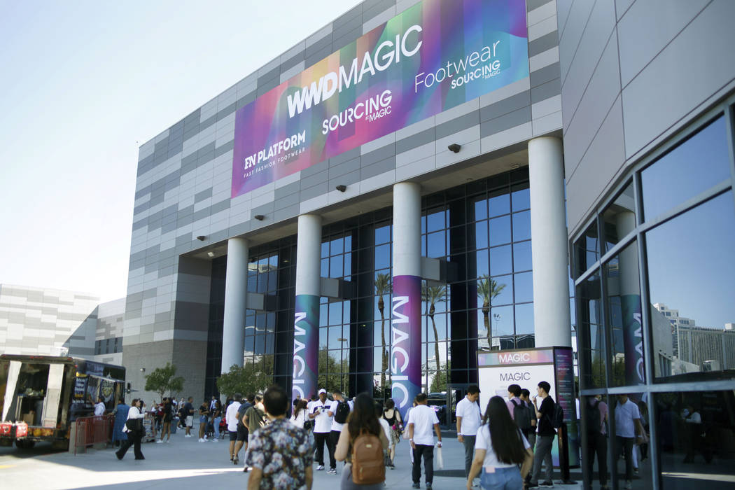 Attendees enter the show during the first day of the MAGIC trade show at the Las Vegas Conventi ...