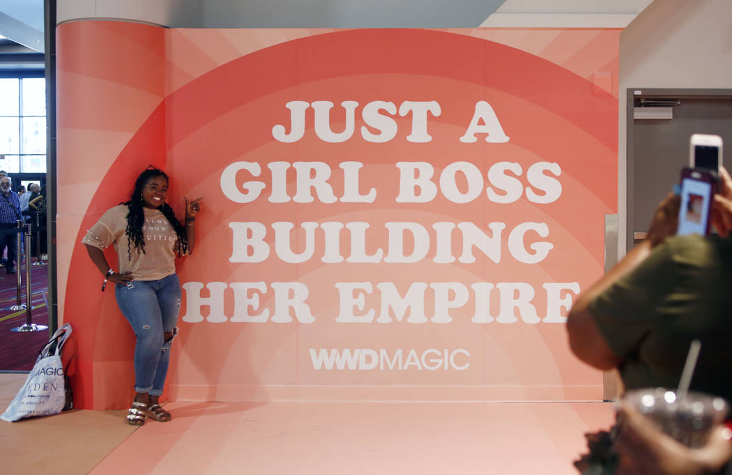 Owner of Buy Me Boutique Jessica Hall poses during the first day of the MAGIC trade show at the ...